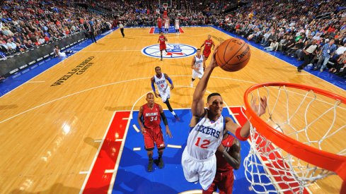 Evan Turner, then with the Philadelphia 76ers, scoring on LeBron James and the Miami Heat.