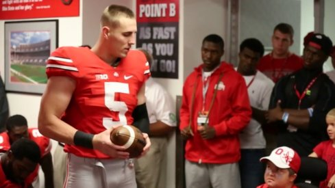 Jeff Heuerman hands the Cincinnati game ball to the Studebaker brothers