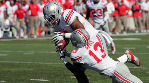 Raekwon McMillan steals a pass from both Maryland and teammate Eli Apple.