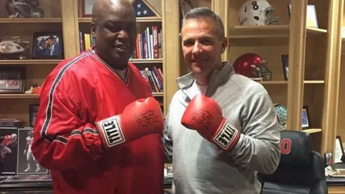 These two know how to throw them thangs, Urban Meyer and Buster Douglas