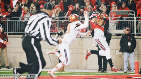 Devin Smith scores the first of his two touchdowns against Illinois.