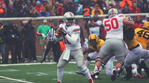 J.T. Barrett threw for 200 and nearly ran for another 200.