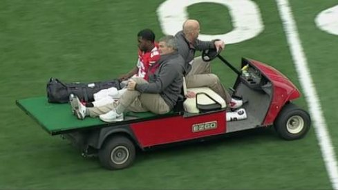 Ohio State quarterback J.T. Barrett carted off the field after injury against Michigan.