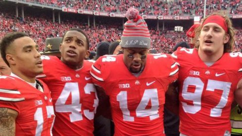 Jalin Marshall, Darron Lee, Curtis Grant and Joey Bosa celebrate Ohio State's 42–28 win over Michigan.