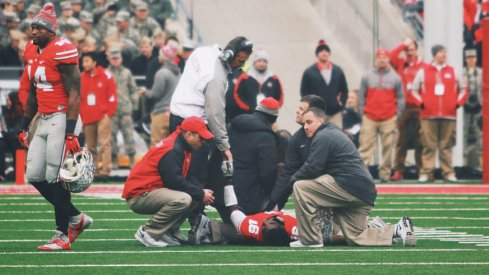 Ohio State quarterback J.T. Barrett is out for the season after breaking his ankle, a team spokesman confirmed.
