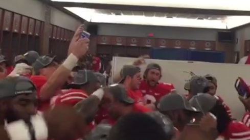The Ohio State football team celebrates in the locker room following their 59–0 drubbing of Wisconsin.