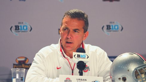 """Summoned to Orlando for the first-ever College Football Playoff semifinal press conference, Urban Meyer talked about a """"monumental"""" game against Alabama and more."""