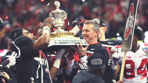Sugar Bowl offensive MVP Ezekiel Elliott and head coach Urban Meyer hoist the Sugar Bowl hardware.