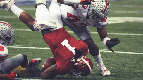 Darron Lee and Doran Grant combine for a tackle.