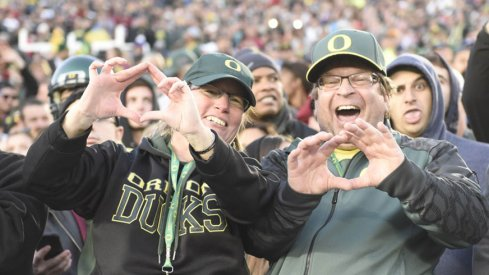 Oregon fans delighting in their Ducks' 59–20 stomping of Florida State.