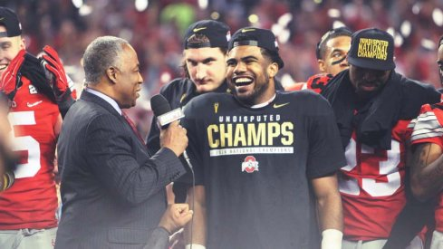 Ezekiel Elliott accepts the National Championship game MVP award Monday night.