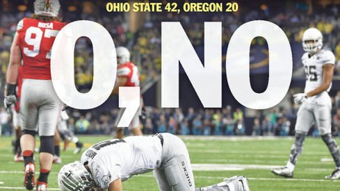 The cover of the Salem Statesman Journal with Marcus Mariota on the ground.