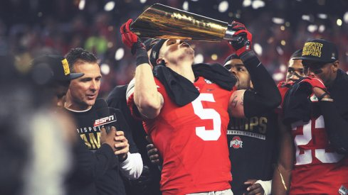 Ohio State senior captain Jeff Heuerman kisses the National Championship trophy.