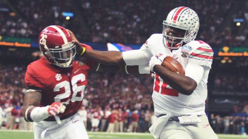 Cardale Jones administering the Stiff Arm of Justice to Alabama's Landon Collins