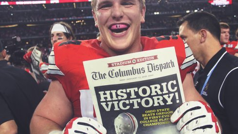 Billy Price holding the Columbus Dispatch after the national title game.