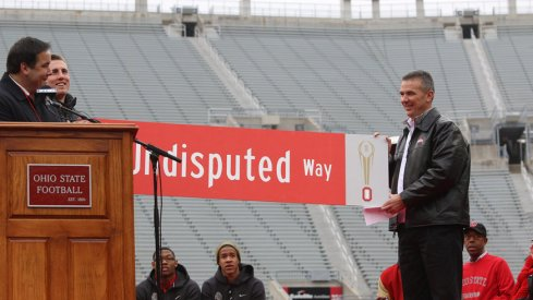 Jeff Heuerman and Urban Meyer hold the new sign, The Undisputed Way
