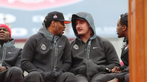Braxton Miller and Joey Bosa talk during Ohio State's national championship celebration Saturday.