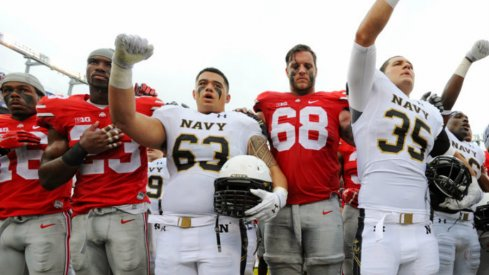 Ohio State and Navy players sing after the game.