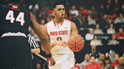 D'Angelo Russell dribbles the ball.
