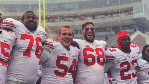 Ohio State's players celebrate a win in frigid Minnesota.