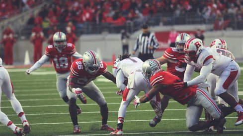 Armani Reeves makes a tackle against Rutgers.