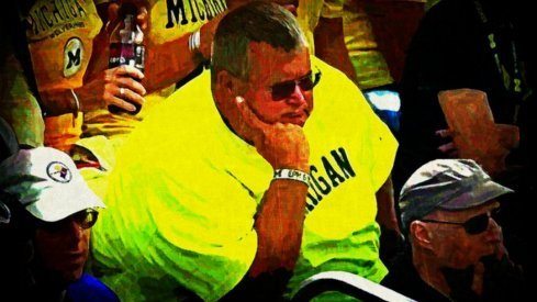Michigan fans watching the Little Brown Jug slip away, 2014
