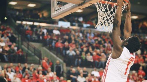 Jae'Sean Tate hangs on the rim.