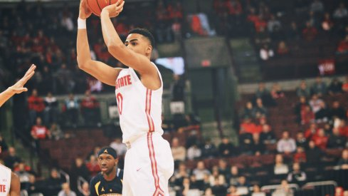 D'Angelo Russell launches a 3-pointer vs. Marquette