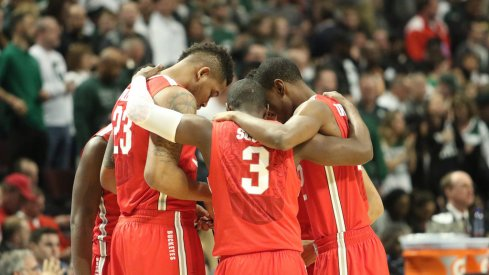 Ohio State huddles vs. Michigan State.