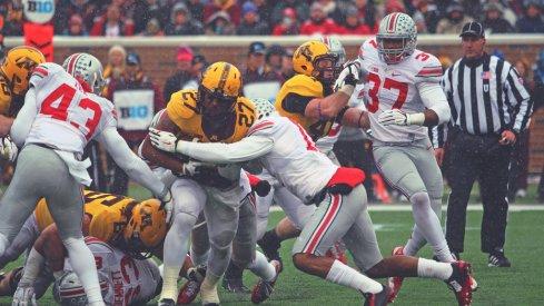 Vonn Bell takes down David Cobb in snowy Minneapolis.