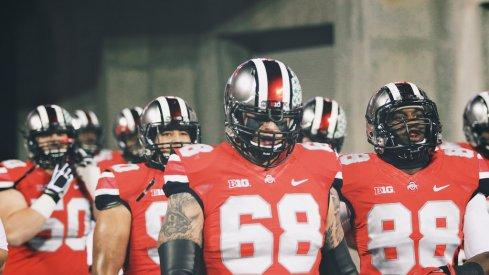 Ohio State led by Taylor Decker into Ohio Stadium.