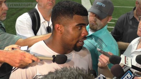 Ezekiel Elliott speaks to the media