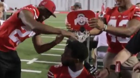 Tyvis Powell and Darron Lee slam on an unsuspecting J.T. Barrett.