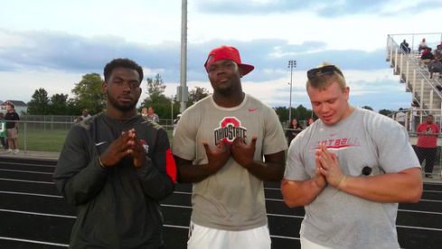 J.T. Barrett, Cardale Jones, and Pat Elflein observe a Pickerington North/Central Crossing game.