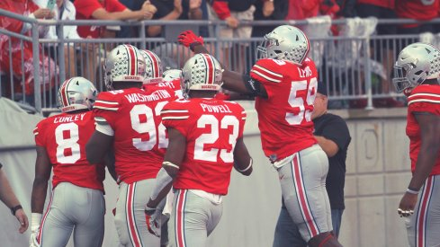 Ohio State celebrates Darron Lee's touchdown.
