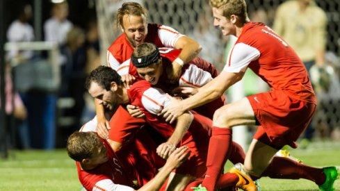 Men's soccer team celebrates a 3-3 draw against No. 11 Akron