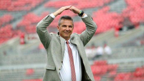 Urban Meyer hits the 'O' during his entrance to Ohio Stadium.