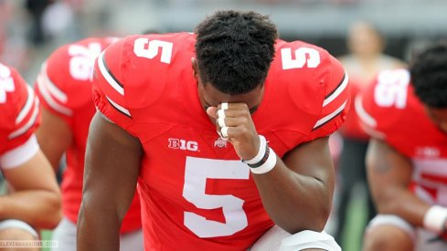 Raekwon McMillan takes a moment before the game.