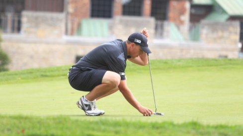 Sophomore Josh Wick Lining Up A Putt