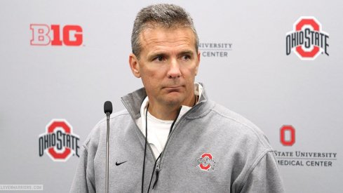 Urban Meyer talks to reporters Wednesday.