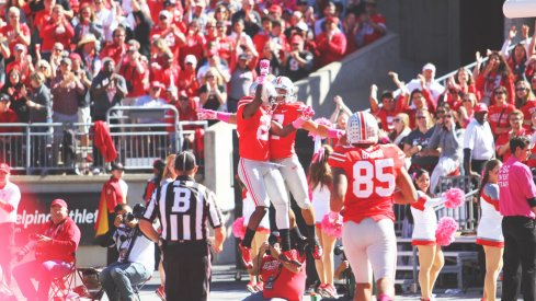 Jalin Marshall and Dontre Wilson celebrate a touchdown