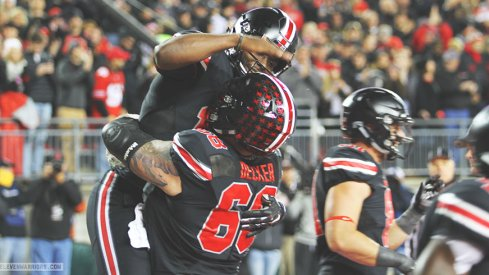 J.T. Barrett and Taylor Decker celebrate in the end zone.