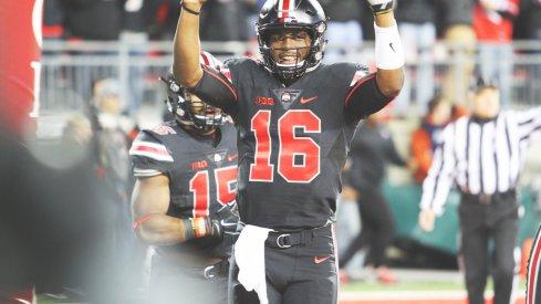 J.T. Barrett celebrates a touchdown.