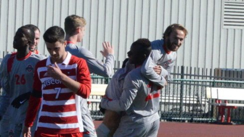 Senior Zach Mason celebrates with freshman Abdi Mohamed.