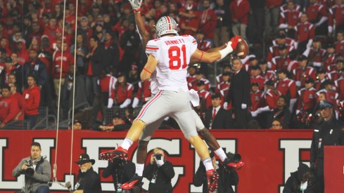 Nick Vannett and Michael Thomas celebrate a touchdown.