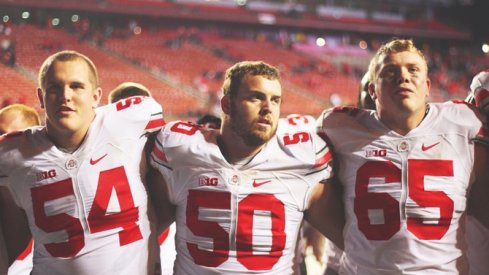 Billy Price, Jacoby Boren, and Pat Elflein sing Carmen Ohio after beating Rutgers.