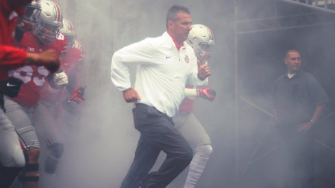 Urban Meyer takes the field.