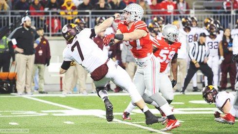 Joey Bosa blasts Minnesota quarterback Mitch Leidner in the first half of Saturday night's game.