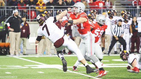 Joey Bosa blasts Minnesota quarterback Mitch Leidner in the first half of Saturday night's game.