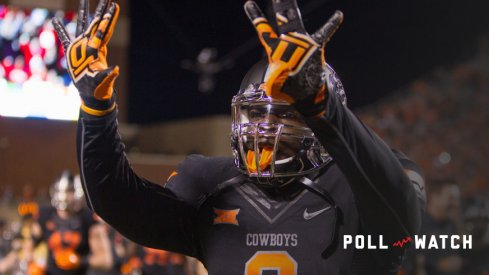 November 7, 2015: Oklahoma State Cowboys linebacker Gyasi Akem (9) celebrates after the Big 12 NCAA football game between the TCU Horned Frogs and the Oklahoma State Cowboys at Boone Pickens Stadium in Stillwater, Oklahoma. Oklahoma State defeated 8th ranked TCU 49-29
